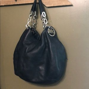 Authentic medium Fulton soft genuine leather bag